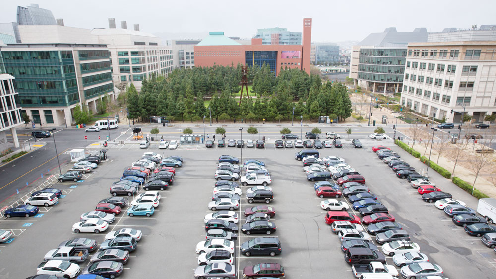 wide view of a surface parking lot at UCSF Mission Bay where the new neurosciences building will be located